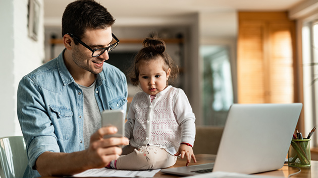 father working from home with daughter
